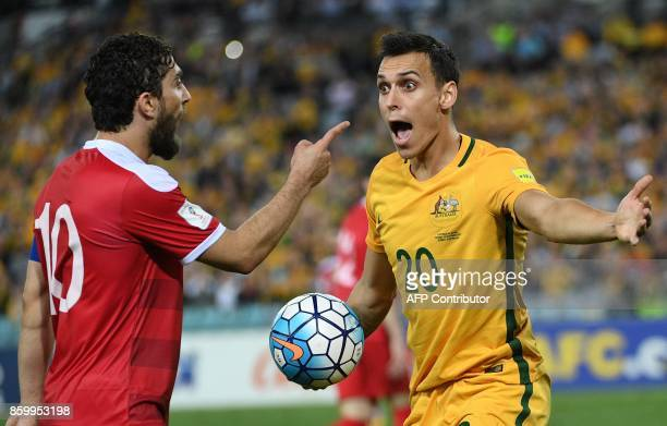 This picture taken on October 10 2017 shows Australia's Trent Sainsbury and Syria's Firas Al Khatib arguing during their 2018 World Cup football...