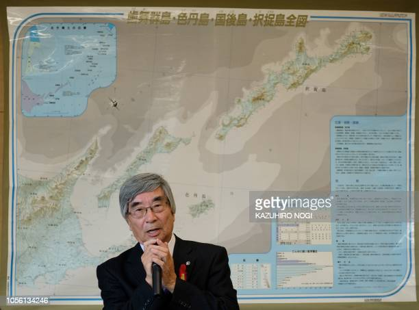 This picture taken on October 10 2018 shows Kimio Waki a former resident of the island of Kunashiri speaking at a press conference at the Rausu...