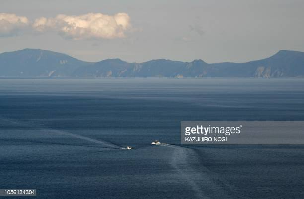 This picture taken on October 10 2018 shows Kunashiri island part of an archipelago under Russian control visible from the Rausu Kunashiri...