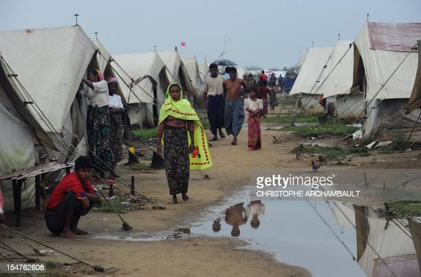 This picture taken on October 11, 2012 shows Muslim Rohingyas at the Say Thamagyi Internally Displaced Persons camp, located on the outskirts of...