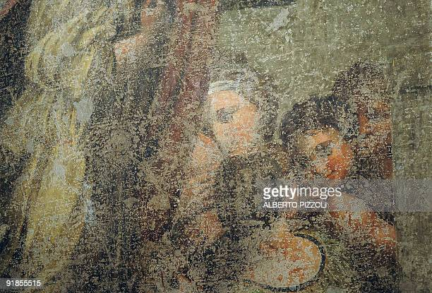 This picture taken on October 13 2009 shows a detail of a fresco found on a wall of a bedroom in a house of Civitavecchia near Rome The fresco is one...