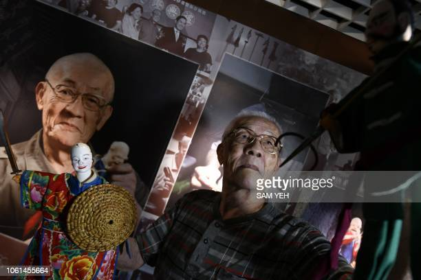 This picture taken on October 13 2018 showing Chen Hsihuang an 87yearold Taiwanese glove puppeteer demonstrating how to use a puppet during an...