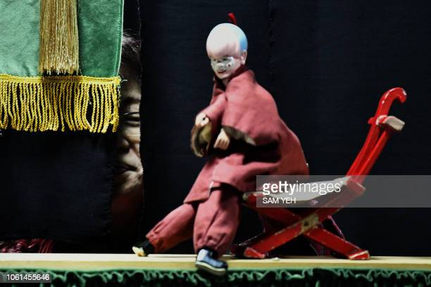 This picture taken on October 13 2018 shows a student of Chen Hsihuang an 87yearold Taiwanese glove puppeteer practicing how to operate a glove...
