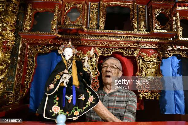 This picture taken on October 13 2018 shows Chen Hsihuang an 87yearold Taiwanese glove puppeteer demonstrating how to use a puppet during an...