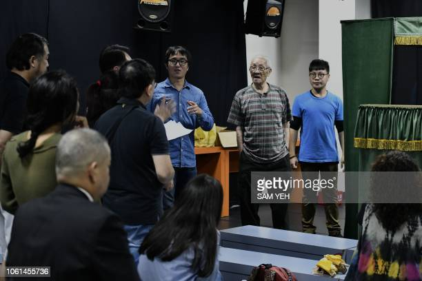 This picture taken on October 13 2018 shows Chen Hsihuang an 87yearold Taiwanese glove puppeteer teaching students how to speak out the scripts at...
