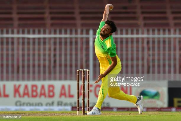 This picture taken on October 13 2018 shows Paktia Panthers' batsman Mohammad Yamin Ahmadzai bowling during the Afghanistan Premier League T20...