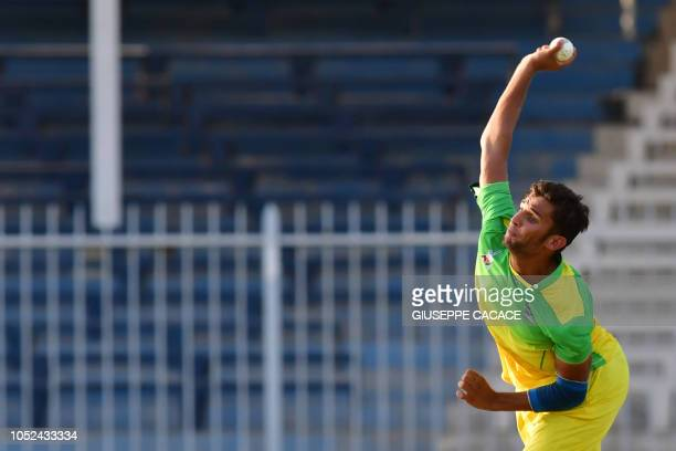 This picture taken on October 13 2018 shows Paktia Panthers' batsman Azmatullah Omarzai bowling during the Afghanistan Premier League T20 cricket...