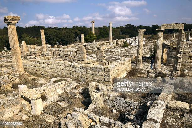 This picture taken on October 13 2018 shows ruins at the archaeological site of the ancient Greek city of Cyrene a colony of the Greeks of Thera and...