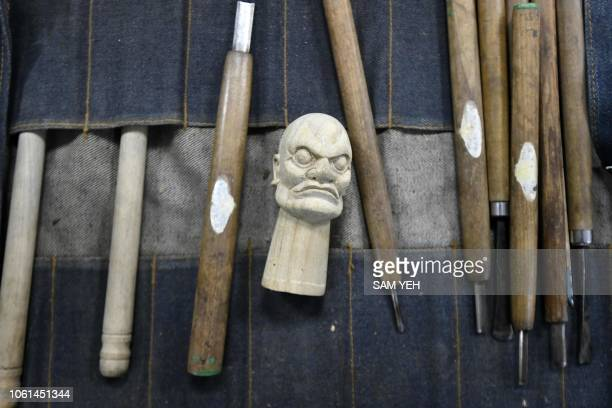 This picture taken on October 13 2018 shows sculpture tools and a puppet head displayed during a sculpture class at Puppetry Art Center in Taipei At...