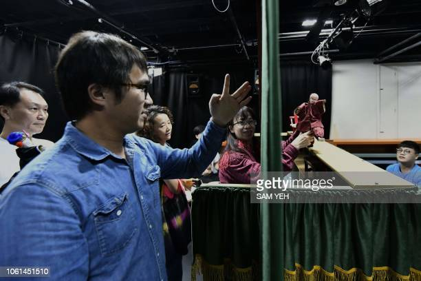 This picture taken on October 13 2018 shows students of Chen Hsihuang an 87yearold Taiwanese glove puppeteer practicing how to perform at Puppetry...