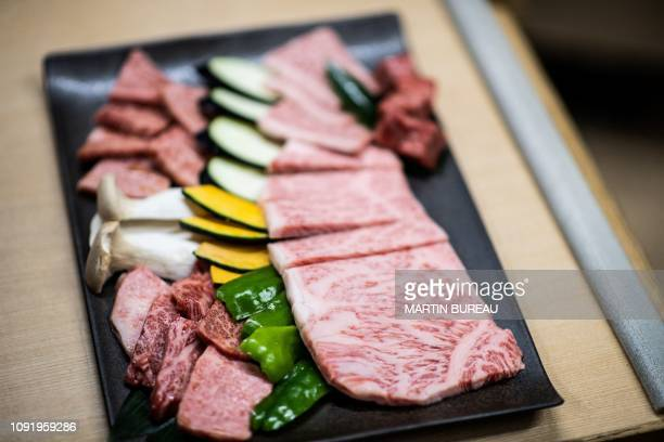 This picture taken on October 13 2018 shows wagyu beef being served at a restaurant in Takayama In a lush field in the heart of the Japanese...