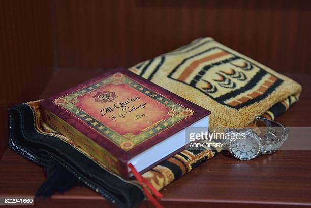 This picture taken on October 15 2016 shows a copy of Koran and a prayer mat at a halalfriendly hotel in Bukit Tinggi West Sumatra West Sumatra West...