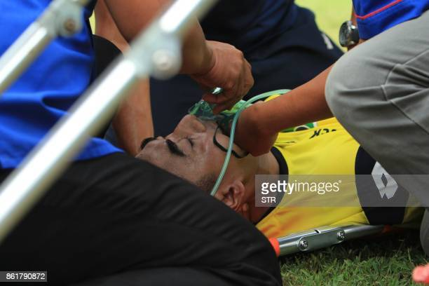 TOPSHOT This picture taken on October 15 2017 shows goalkeeper Choirul Huda of hometown club Persela in East Java receiving treatment moments after a...