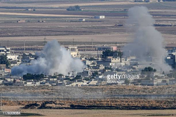 This picture taken on October 15 2019 from the Turkish side of the border at Ceylanpinar district in Sanliurfa shows smoke rising from the Syrian...