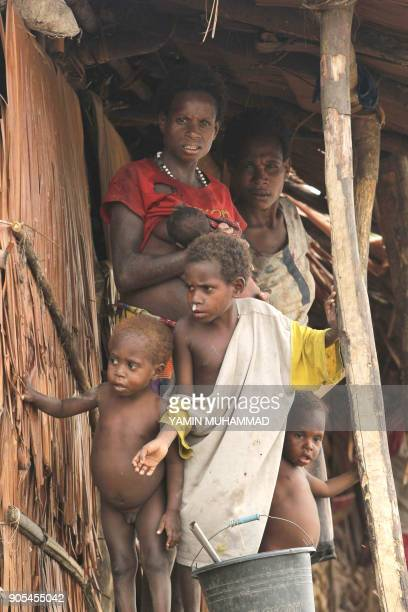 This picture taken on October 16 2016 shows a group of Papuan children at their village home in Asmat in a regency in Indonesia's easternmost...