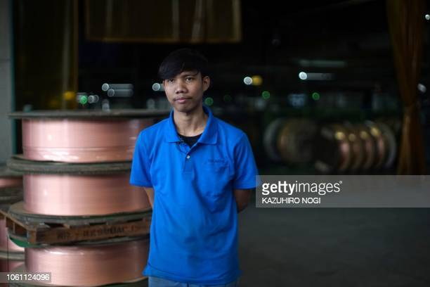 This picture taken on October 16 2018 shows Jaman an Indonesian worker at Japan's Nakamoto Mfg factory speaking during an interview with AFP in...
