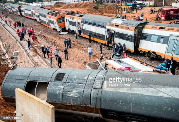 This picture taken on October 16 2018 shows the scene of a rail accident in the Moroccan town of Bouknadel between the capital Rabat and the port...