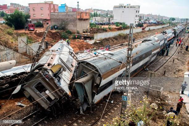 TOPSHOT This picture taken on October 16 2018 shows the scene of a rail accident in the Moroccan town of Bouknadel between the capital Rabat and the...