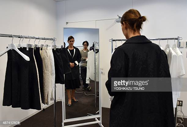STORY JAPONMODELUXE BY This picture taken on October 17 2014 shows a French buyer of Paris department store Galeries Lafayette checking clothes of...
