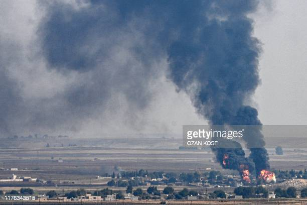 TOPSHOT This picture taken on October 17 2019 from the Turkish side of the border with Syria in the Ceylanpinar district city of Sanliurfa shows...