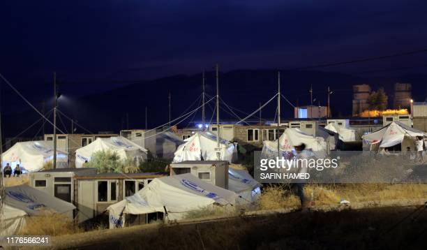 This picture taken on October 18, 2019 shows a view of shelters at the Bardarash refugee camp near the Kurdish city of Dohuk, in Iraq's autonomous...