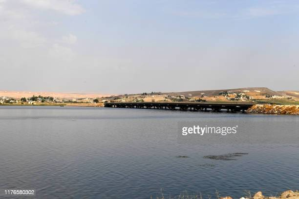 This picture taken on October 18, 2019 shows a view of the the Qarah Qozak bridge along the Euphrates river in the north of Aleppo governorate near...
