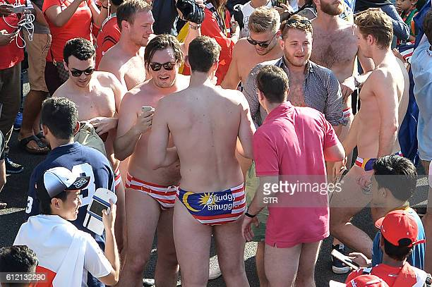 This picture taken on October 2 2016 shows spectators with swimwear bearing a Malaysian flag during the Formula One Malaysian Grand Prix in Sepang...