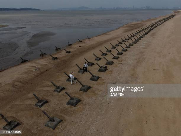 This picture taken on October 20, 2020 show tourists visiting the anti landing spikes on the coast of Kinmen, the front line islands of Taiwan.