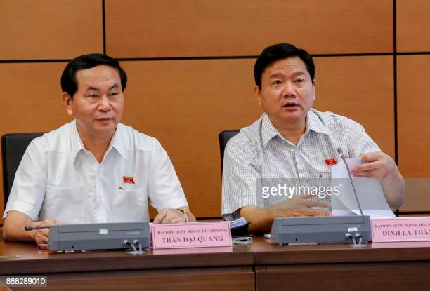 This picture taken on October 21 2016 shows politburo member Dinh La Thang speaking next to Vietnamese President Tran Dai Quang during a national...