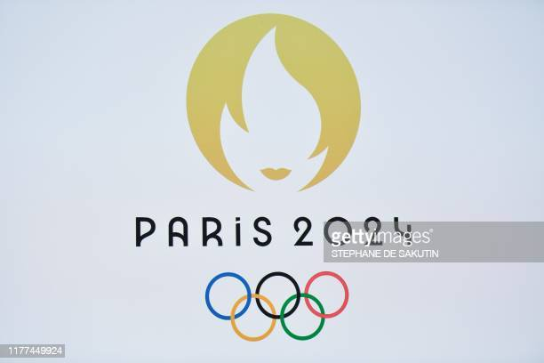 TOPSHOT This picture taken on October 21 2019 shows a logo during a logo presentation ceremony for Paris 2024 Olympic Games at the Grand Rex cinema...