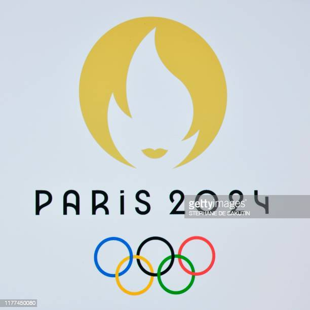 This picture taken on October 21 2019 shows a logo during a logo presentation ceremony for Paris 2024 Olympic Games at the Grand Rex cinema in Paris