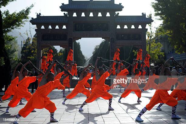 This picture taken on October 22, 2012 shows kungfu students performing at a Shaolin Temple to welcome guests during the 9th Zhengzhou International...