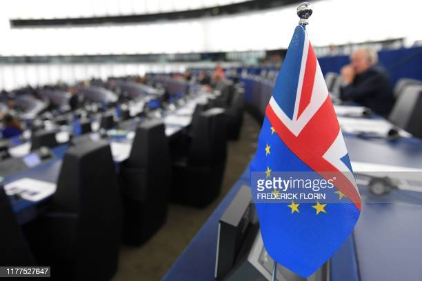 This picture taken on October 22 shows a half English and half European flag during a debate on the last EU summit and Brexit at the European...