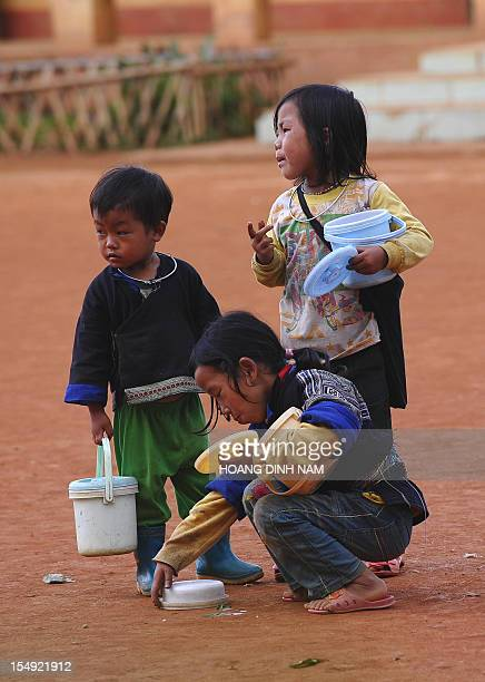 This picture taken on October 23 2012 shows ethnic Hmong hill tribe children as they walk home after a school day at a village in the mountainous...