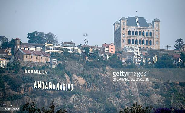 This picture taken on October 23, 2013 shows the name of Antananarivo displayed on a hill under the name of the presidential candidate Edgard...