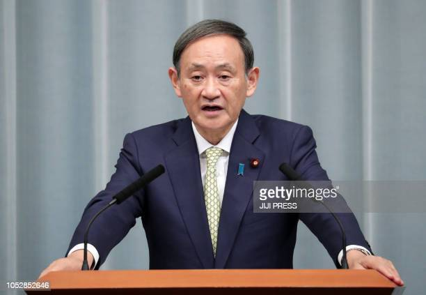 This picture taken on October 23 2018 shows Japan's Chief Cabinet Secretary Yoshihide Suga speaking during a press conference regarding kidnapped...