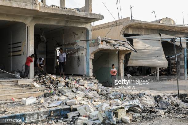 This picture taken on October 23, 2019 shows rubble in a street at the scene of an explosion in the Syrian town of Suluk, near Tal Abyad close to the...