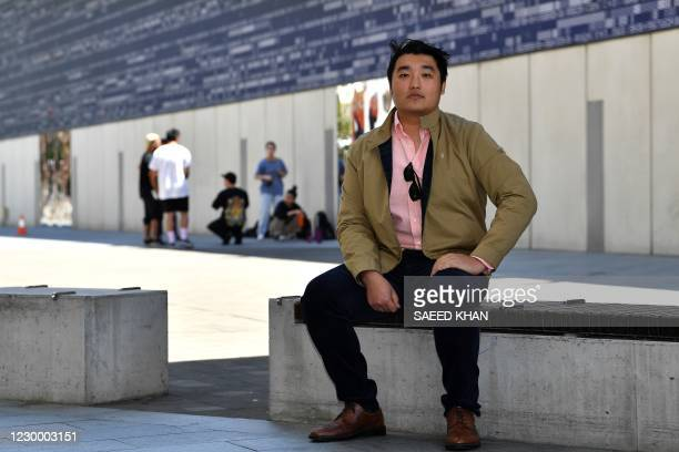 This picture taken on October 23, 2020 shows Frank Li, founder of the Chiefs eSports Club, posing during an interview at Darling Harbour in Sydney. -...
