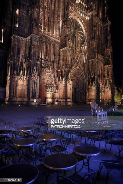 This picture taken on October 24 shows the empty terrace of a closed restaurant in front of the Cathedral of Our Lady of Strasbourg, eastern France,...