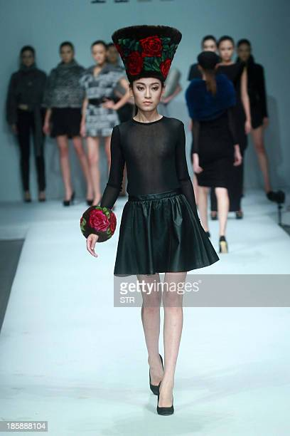 This picture taken on October 25 2013 shows a model parading a creation from the Kopenhagen Fur Collection during the China Fashion Week in Beijing...