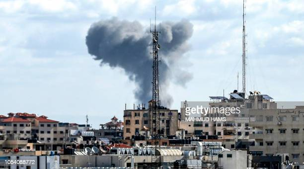 This picture taken on October 27 2018 shows a smoke plume rising following Israeli bombardment in Gaza City A barrage of rockets from Gaza hit Israel...