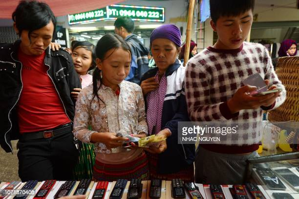 This picture taken on October 28 2018 shows Vietnamese people shopping at the Sunday market in Meo Vac a mountainous border district between...