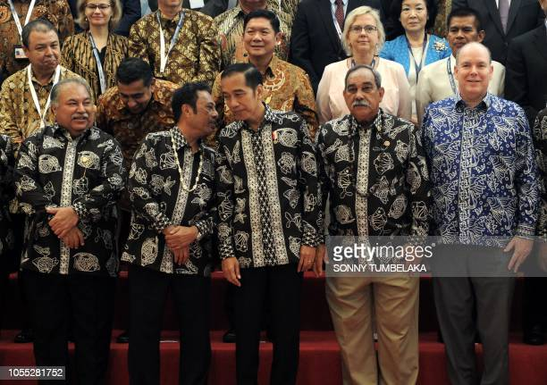 This picture taken on October 29 2018 shows from L to R Nauru President Baron Waqa Palau's President Tommy Remengesau Jr Indonesian President Joko...