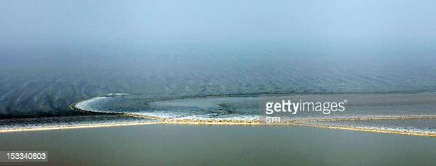 This picture taken on October 3 2012 shows a tidal wave coming in at the mouth of the Qiantang river in Haining in eastern China's Zhejiang province...