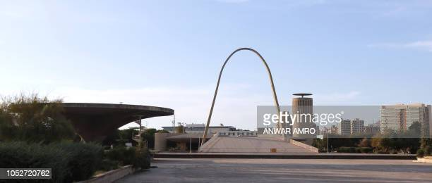 This picture taken on October 3 2018 shows a view of the thin concrete arch at the grounds of the Tripoli International Fair close to the seafront of...
