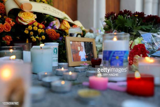 This picture taken on October 30, 2020 shows the tribute to Vincent Loques, one of the victims of a knife attacker, outside the Notre-Dame de...