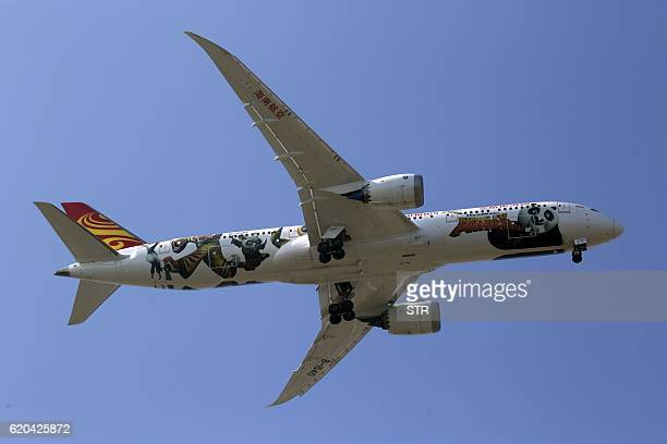 This picture taken on October 31 2016 shows a Hainan Airlines Boeing 787 performing at the Zhuhai Air Show in Zhuhai in southern China's Guangdong...