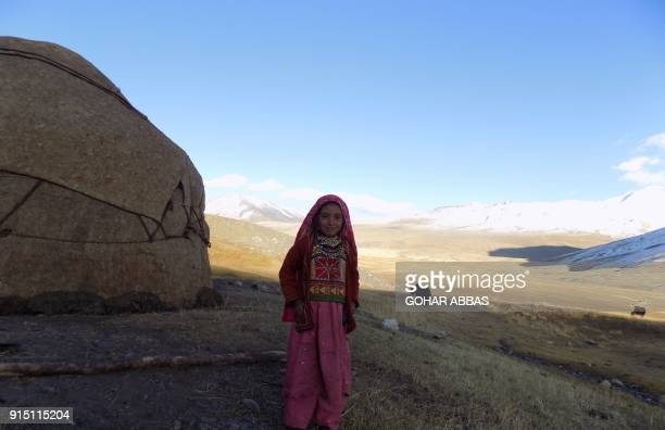 TOPSHOT This picture taken on October 8 2017 shows a Kyrgyz girl standing outside her traditional yurt in the Wakhan Corridor in Afghanistan For...