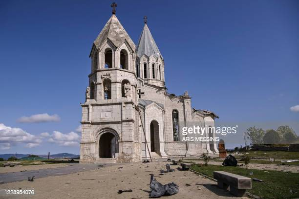 This picture taken on October 8, 2020 shows the damaged Ghazanchetsots Cathedral in the historic city of Shusha, some 15 kilometers from the disputed...