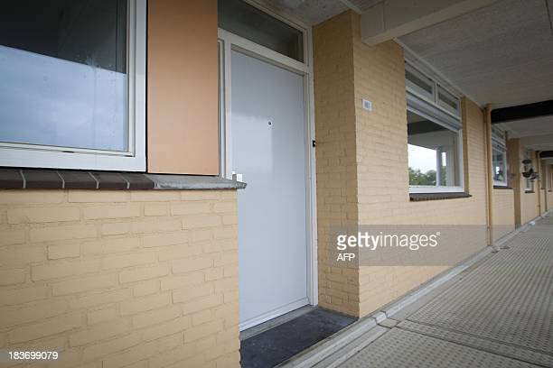 This picture taken on October 9 2013 shows the entrance to the apartment where Frank R has lived for many years in Cuijk Dutch police are...